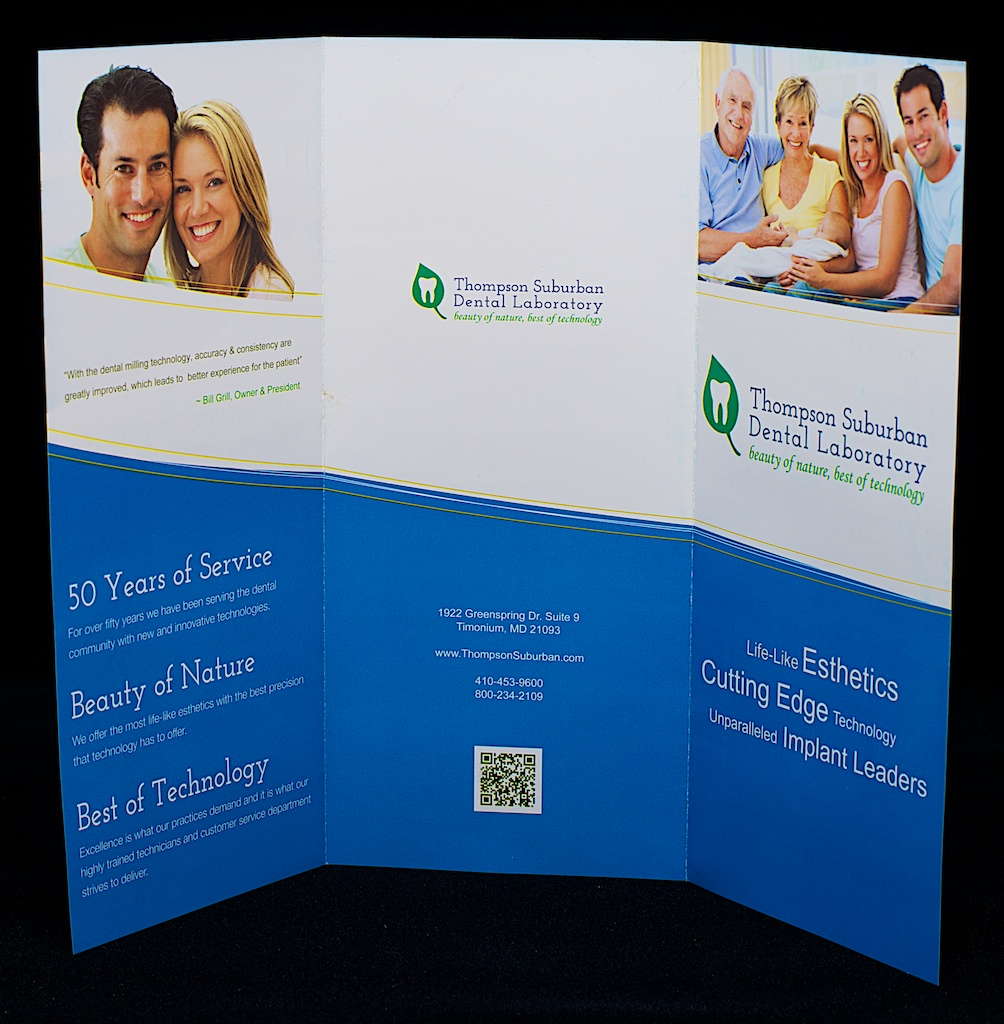 The outside of the Thompson Suburban Dental brochure features the logo we designed in 2012.